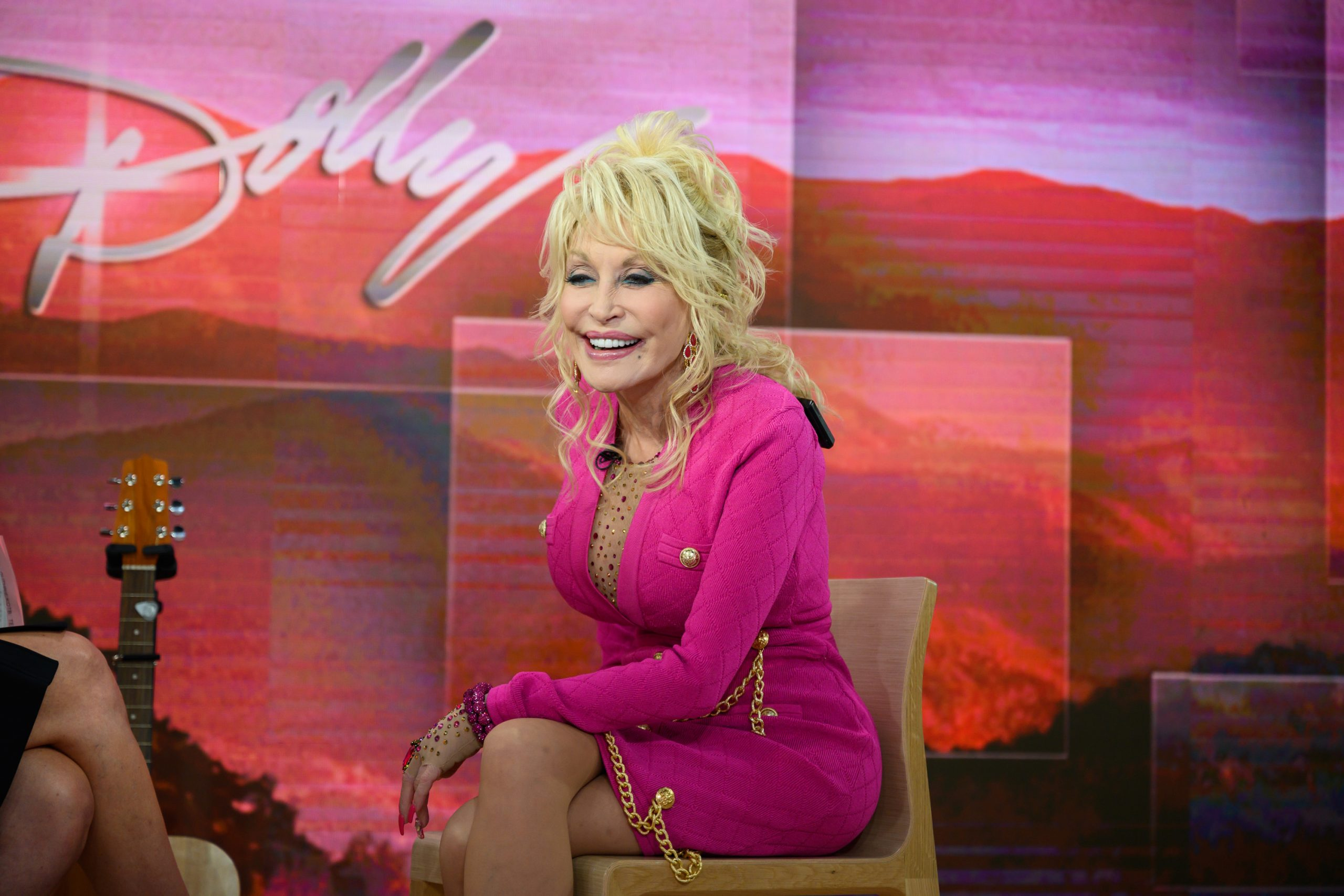 Dolly Parton wearing a bright pink dress on the Today show in 2019