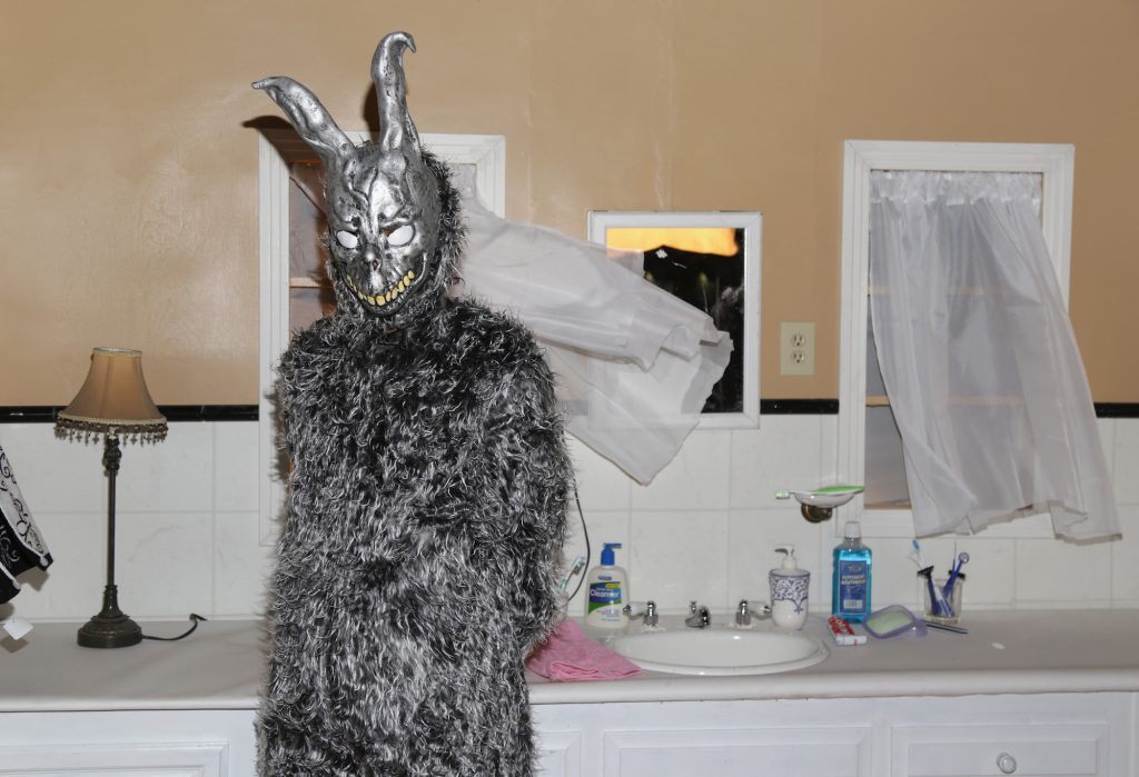 Frank (character in rabbit suit) from 'Donnie Darko' in a bathroom