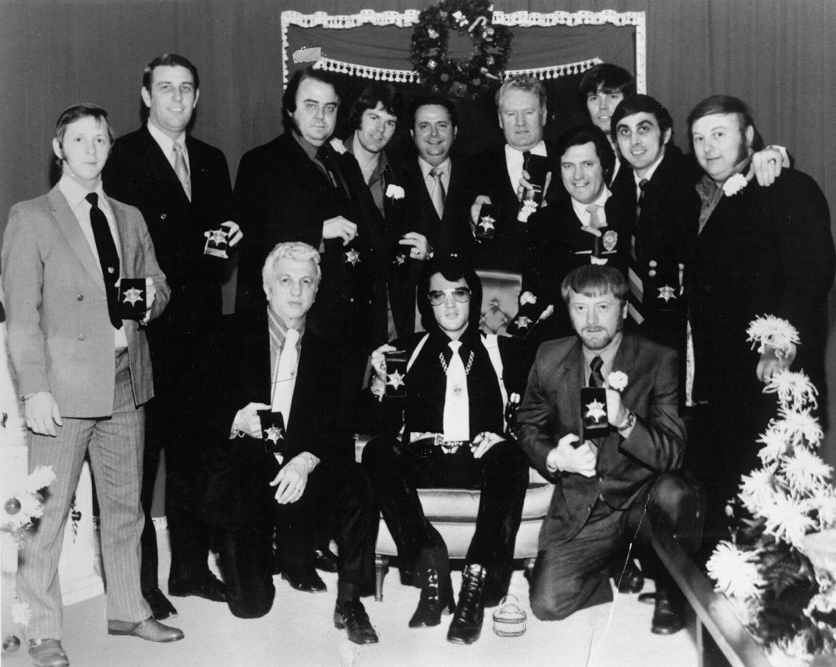 Elvis Presley with members of his entourage, including Sonny West, in 1970