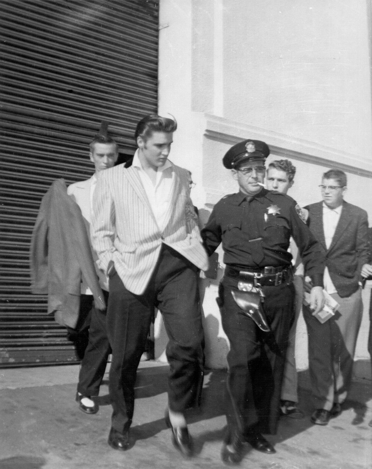Elvis Presley with police and security in 1956