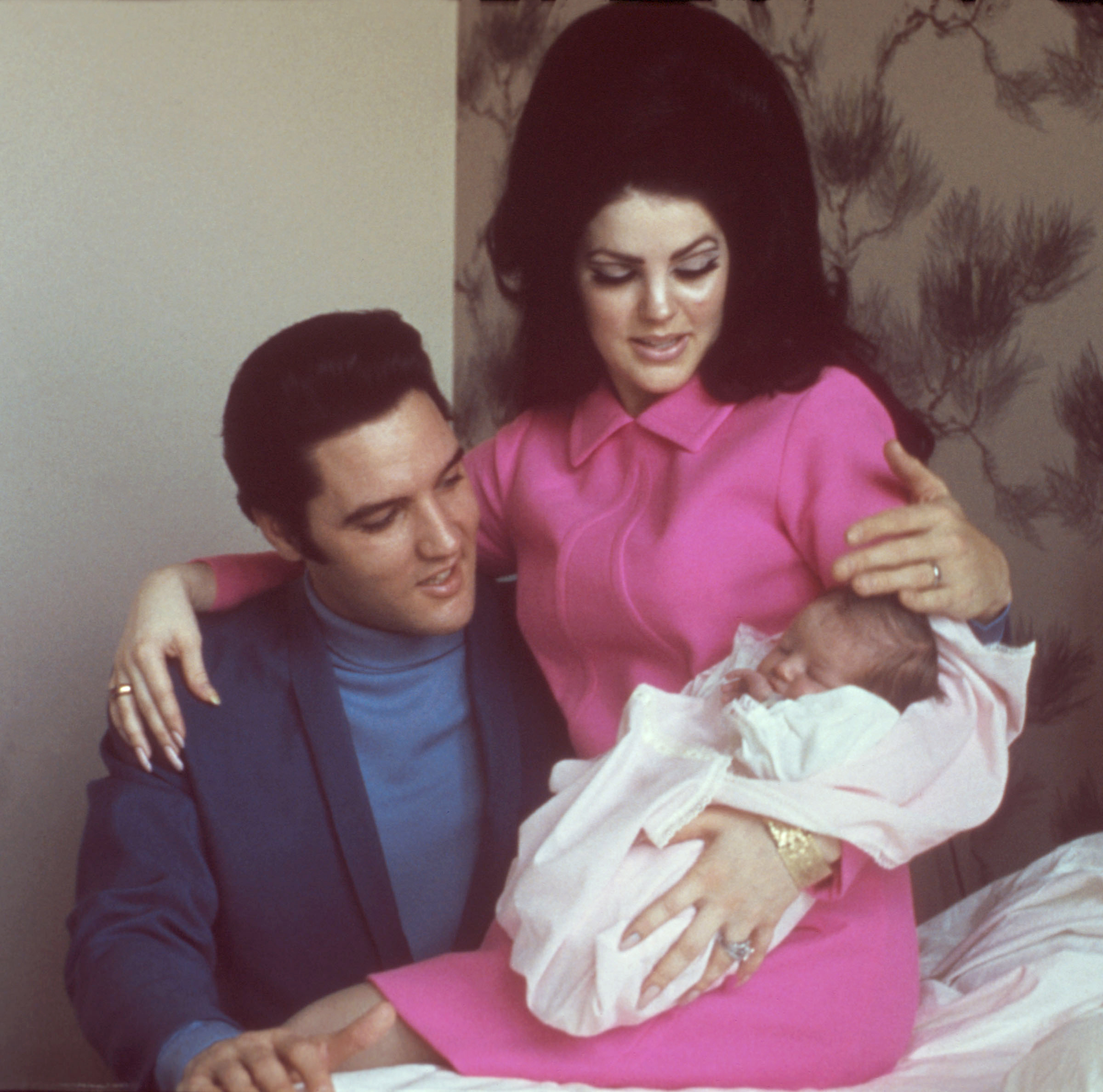 Rock and roll singer Elvis Presley with his wife Priscilla Beaulieu Presley and their 4 day old daughter Lisa Marie Presley on February 5, 1968 in Memphis, Tennessee.