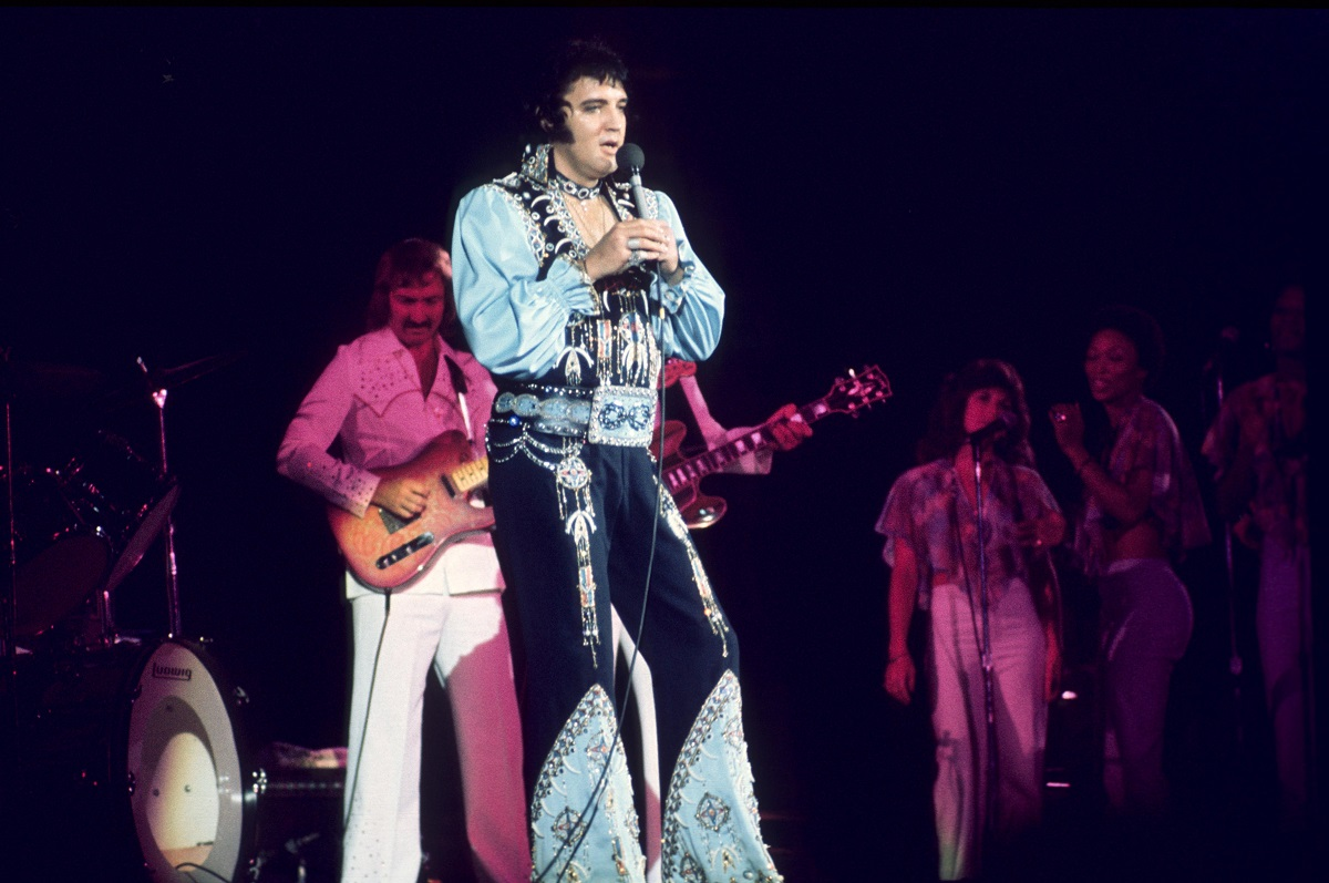 Elvis Presley performing with James Burton and the TCB Band