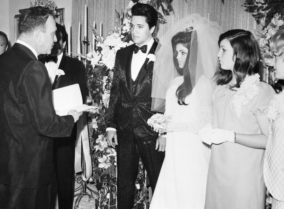 Elvis Presley and his bride, the former Priscilla Ann Beaulieu, are pronounced man and wife by Nevada Supreme Court Justice David Zenoff at the Aladdin Hotel. The bride's sister, Michelle Beaulieu (r) served as Maid of Honor at the wedding.