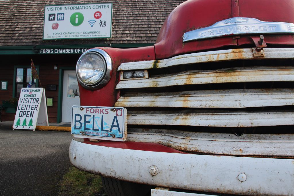 An old Chevrolet is parked in front of the visitor centre in the small town of Forks