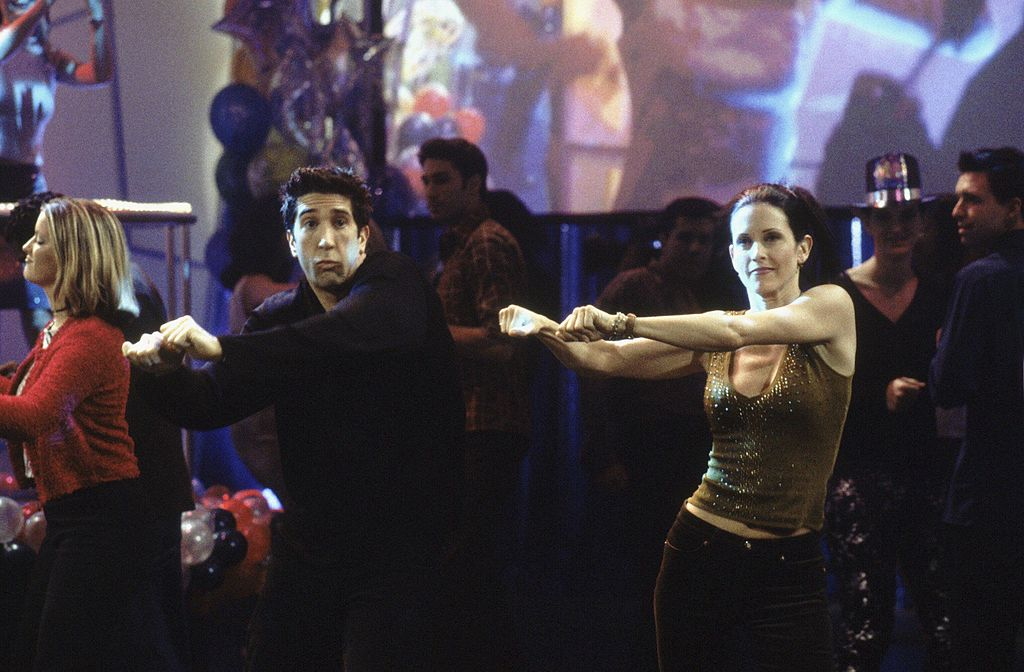 "Friends cast David Schwimmer as Ross Geller, Courteney Cox as Monica Geller dancing in the season 6 episode  ""The One With The Routine"""