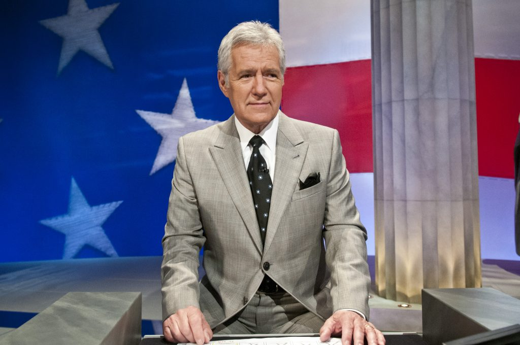 Alex Trebek stands at his podium during a taping of 'Jeopardy!'