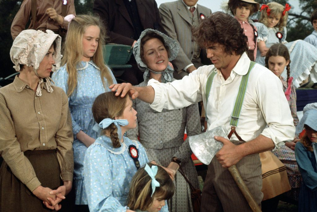 Michael Landon, right, on the set of 'Little House' with cast, 1975