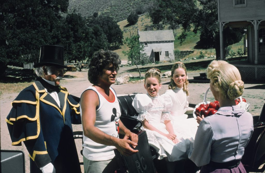 Michael Landon on the set of 'Little House on the Prairie' with cast, 1975