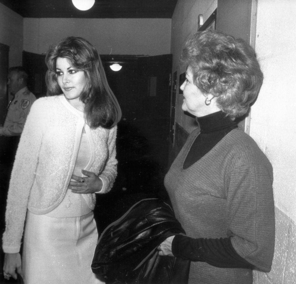 Ginger Alden (L), Elvis Presley's former girlfriend, is shown with her mother, Jo Alden, outside the courtroom