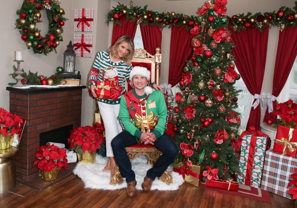 (L-R) Debbie Matenopoulos and Nick Lachey smiling in front of a Christmas tree on Hallmark's 'Home & Family'