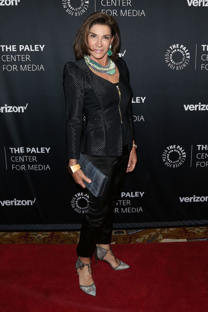 Hilary Farr smiling in front of a black background