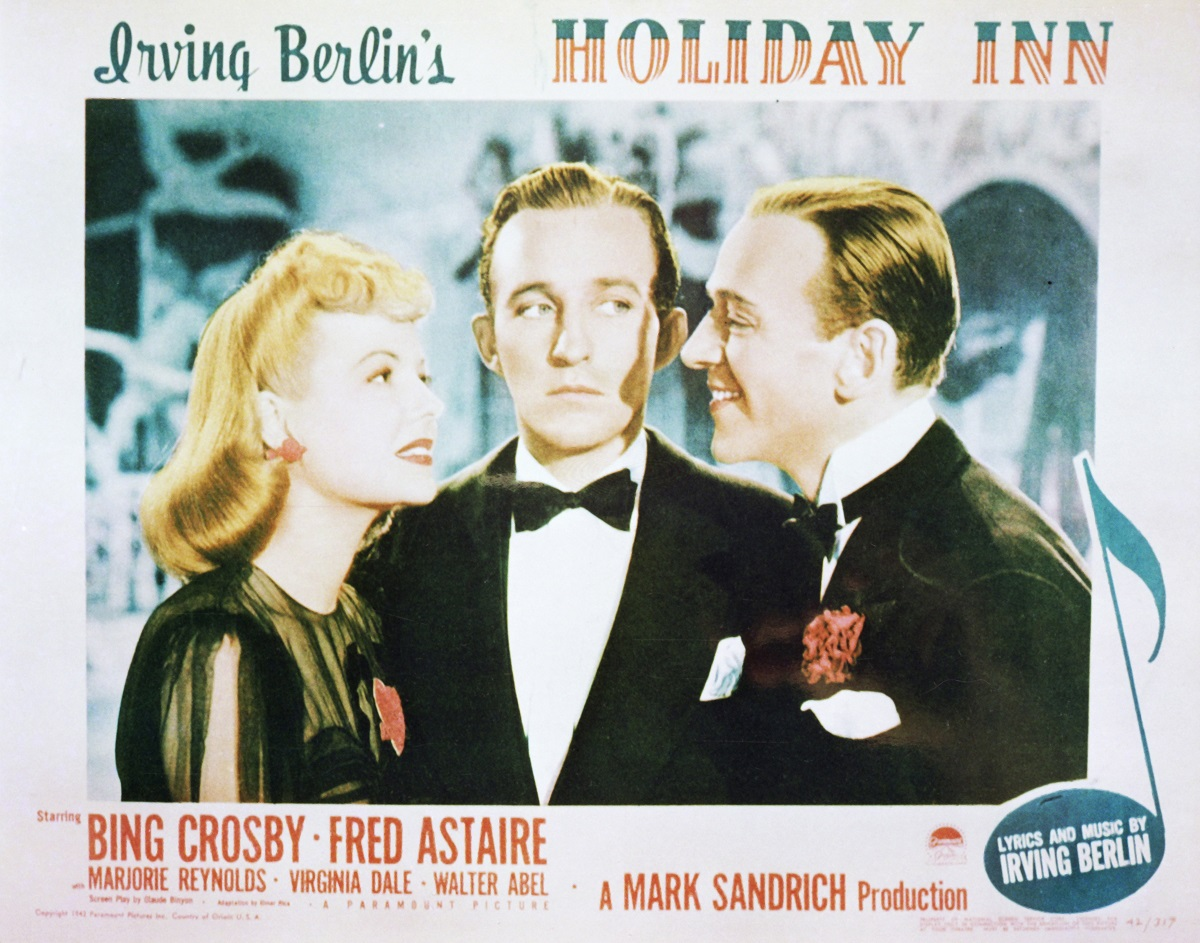 A lobby card for Mark Sandrich's 1942 film musical 'Holiday Inn' with Marjorie Reynolds, Bing Crosby, and Fred Astaire
