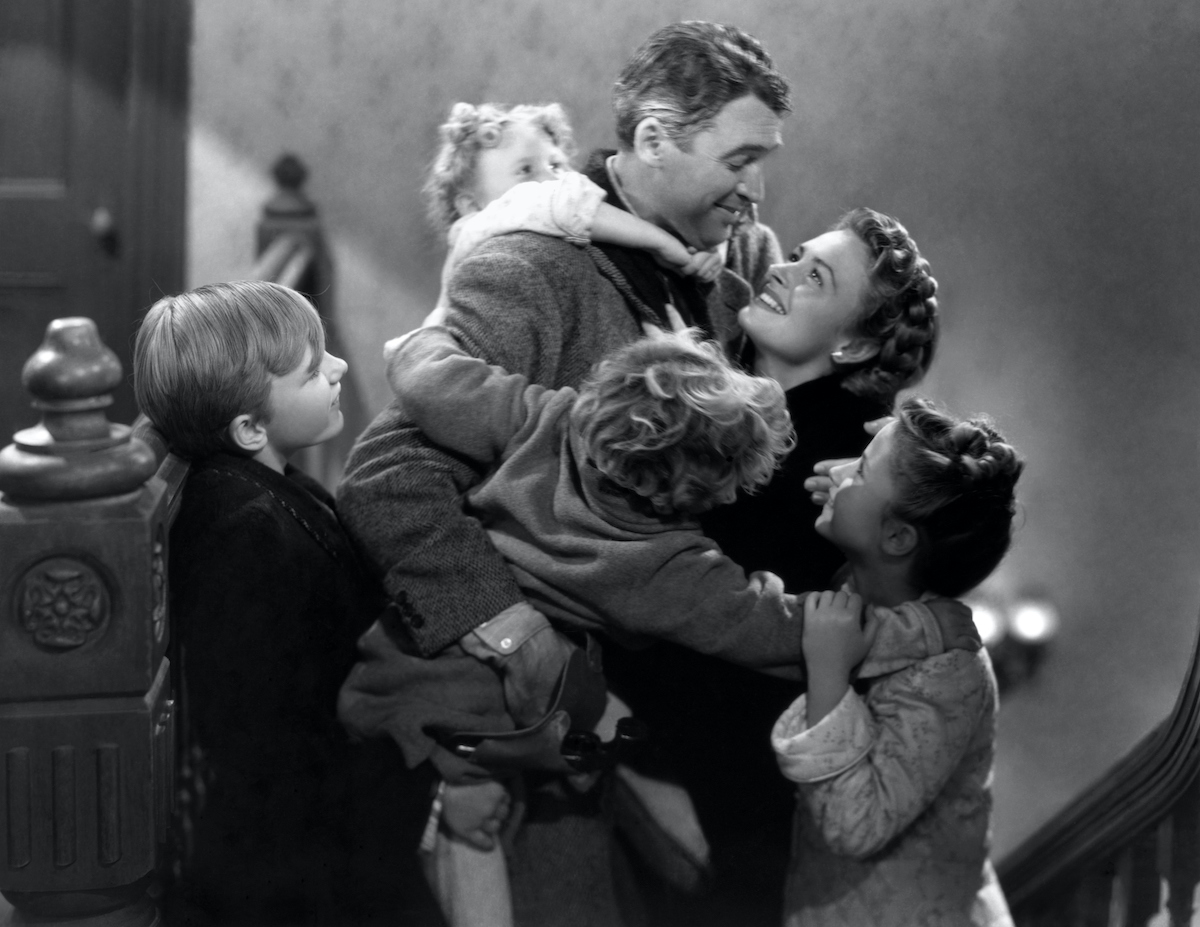 James Stewart, Donna Reed, Carol Coombs, Jimmy Hawkins, Larry Simms, and Karolyn Grimes in 'It's a Wonderful Life'