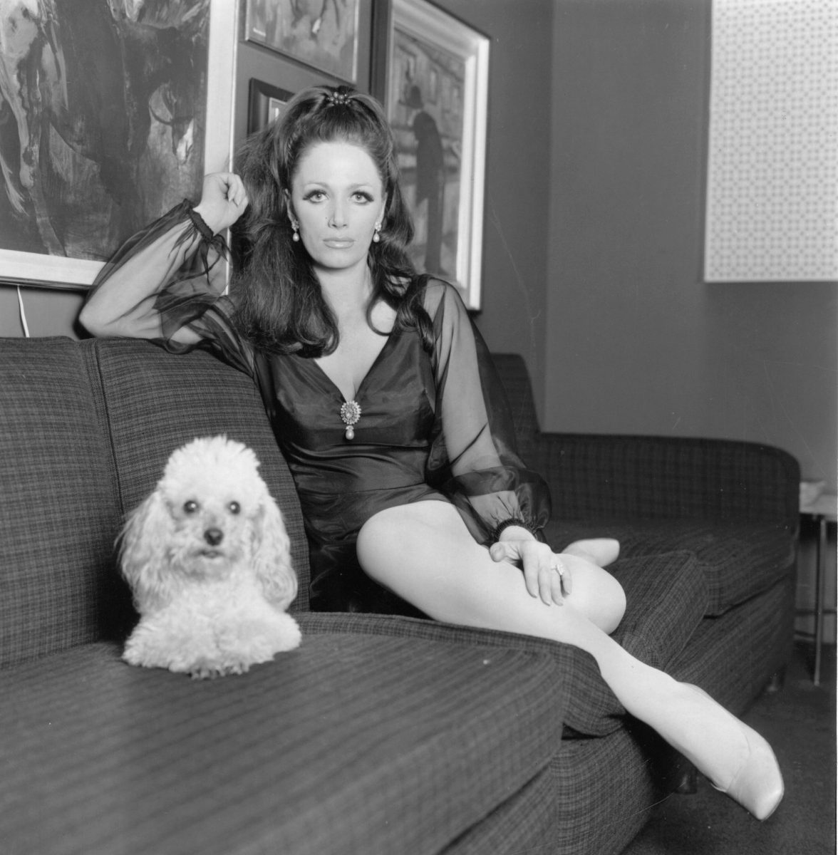 Jackie Collins, at home with her pet poodle