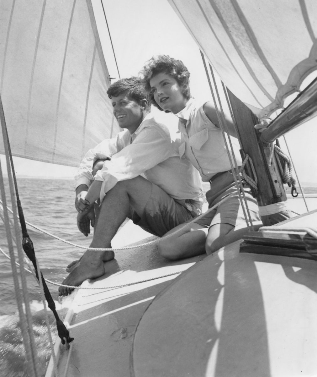 HYANNIS PORT, MA - 1953: Senator John F. Kennedy and fiance Jacqueline Bouvier go sailing while on vacation at the Kennedy compound