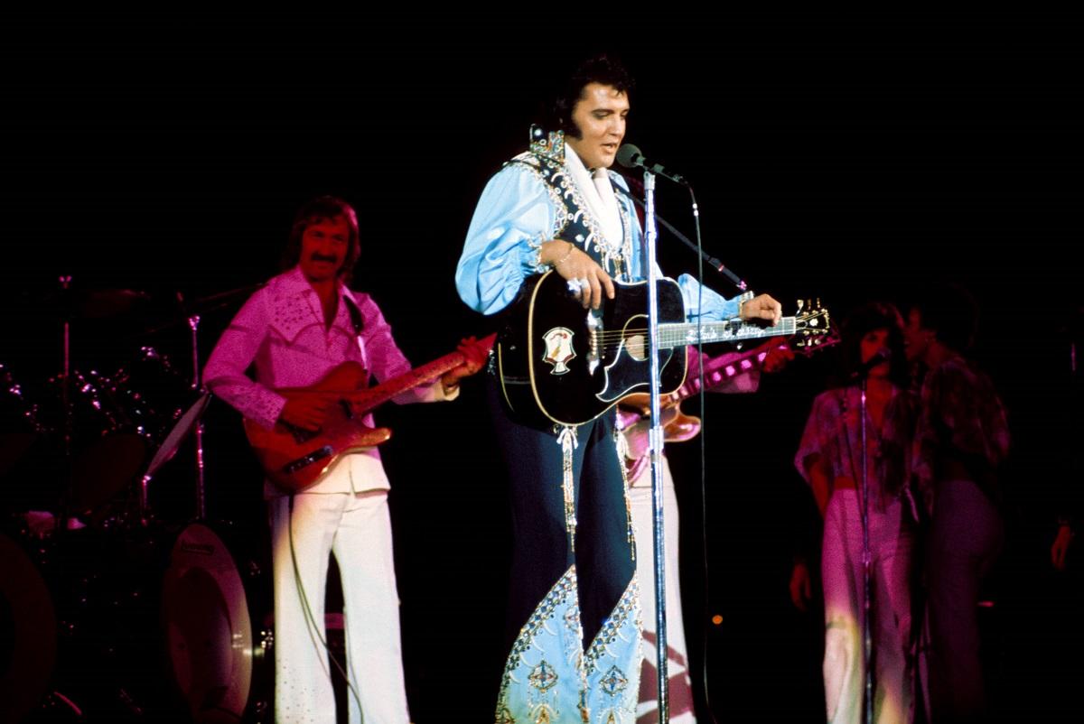James Burton and Elvis Presley performing