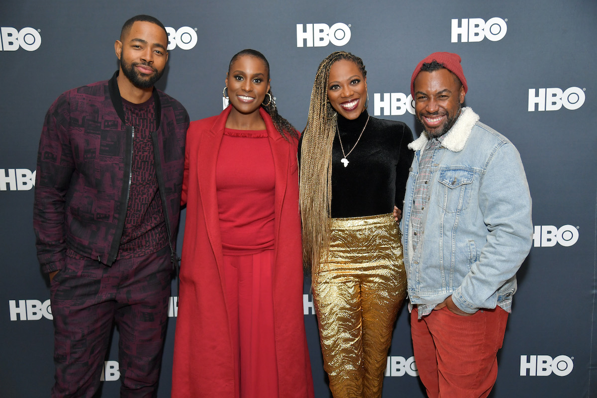 Some of the cast and crew of HBO's 'Insecure' pose for a photo on the red carpet