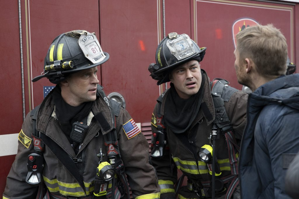 Jesse Spencer and Taylor Kinney on the set of Chicago Fire | Adrian Burrows/NBC/NBCU Photo Bank via Getty Images