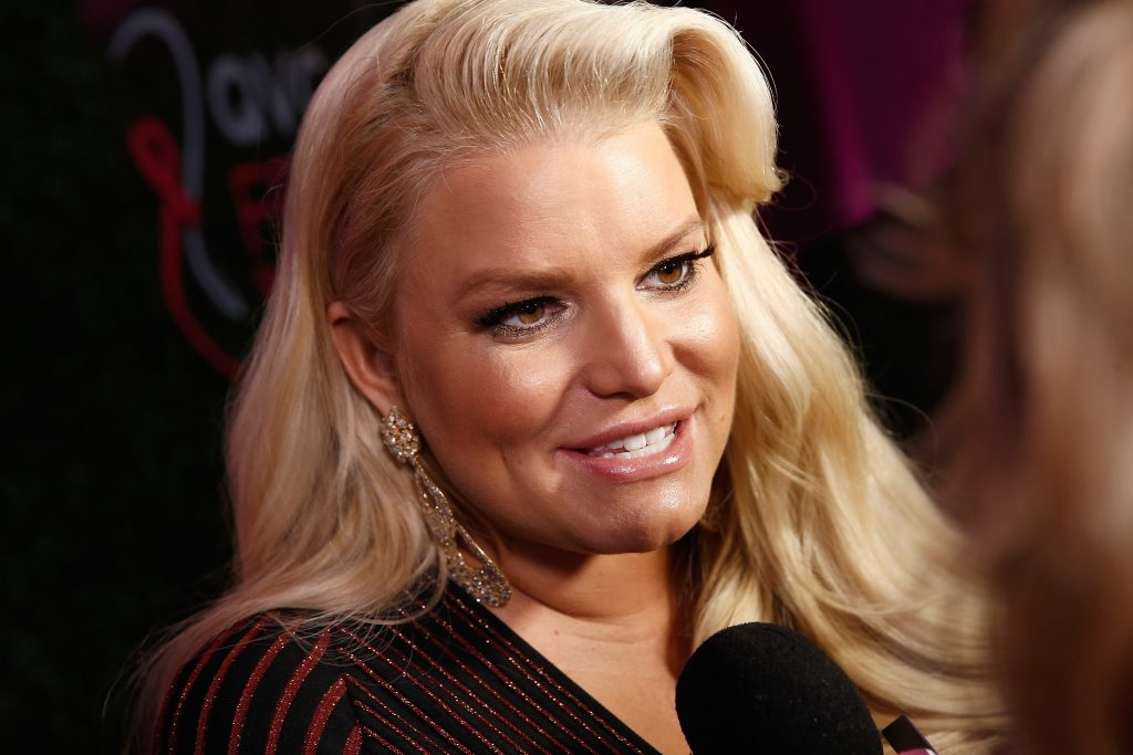 Jessica Simpson smiles for a photo on the red carpet