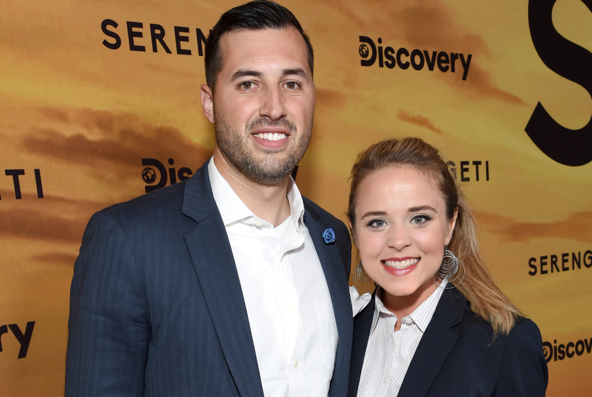 Smiling Jeremy Vuolo and Jinger Duggar at a Discovery Channel event