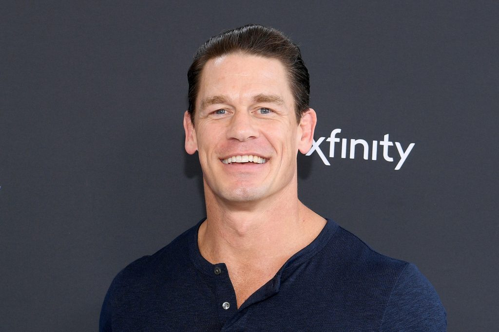 John Cena smiling in front of a black background