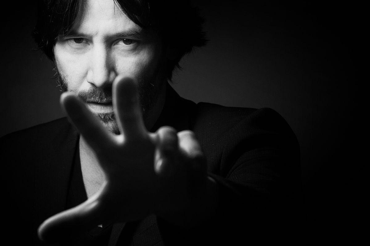 Keanu Reeves poses in Paris