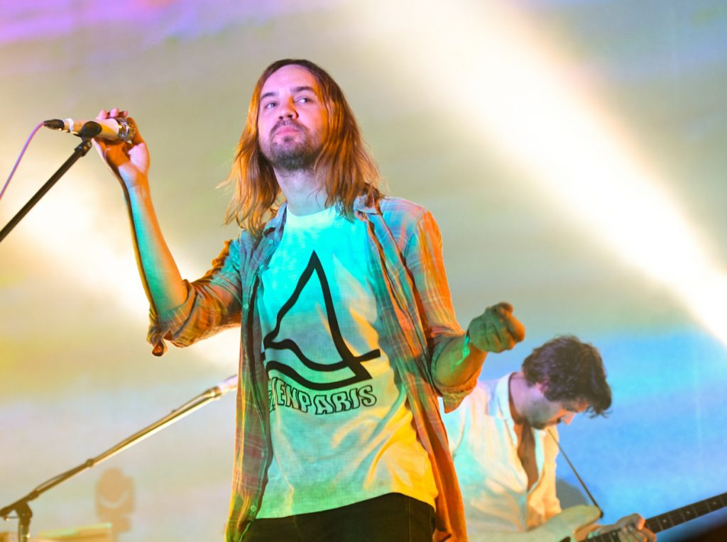 Kevin Parker performing at a music festival