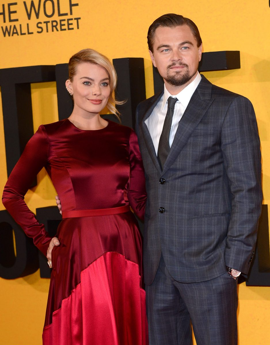 """Margot Robbie and Leonardo DiCaprio attend the UK Premiere of """"The Wolf Of Wall Street"""" at the Odeon Leicester Square on January 9, 2014 in London, England."""
