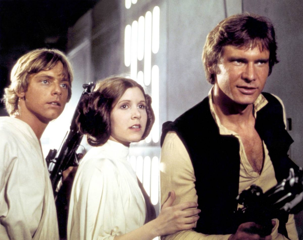 American actors Mark Hamill, Carrie Fisher and Harrison Ford on the set of Star Wars: Episode IV - A New Hope written, directed and produced by Georges Lucas.