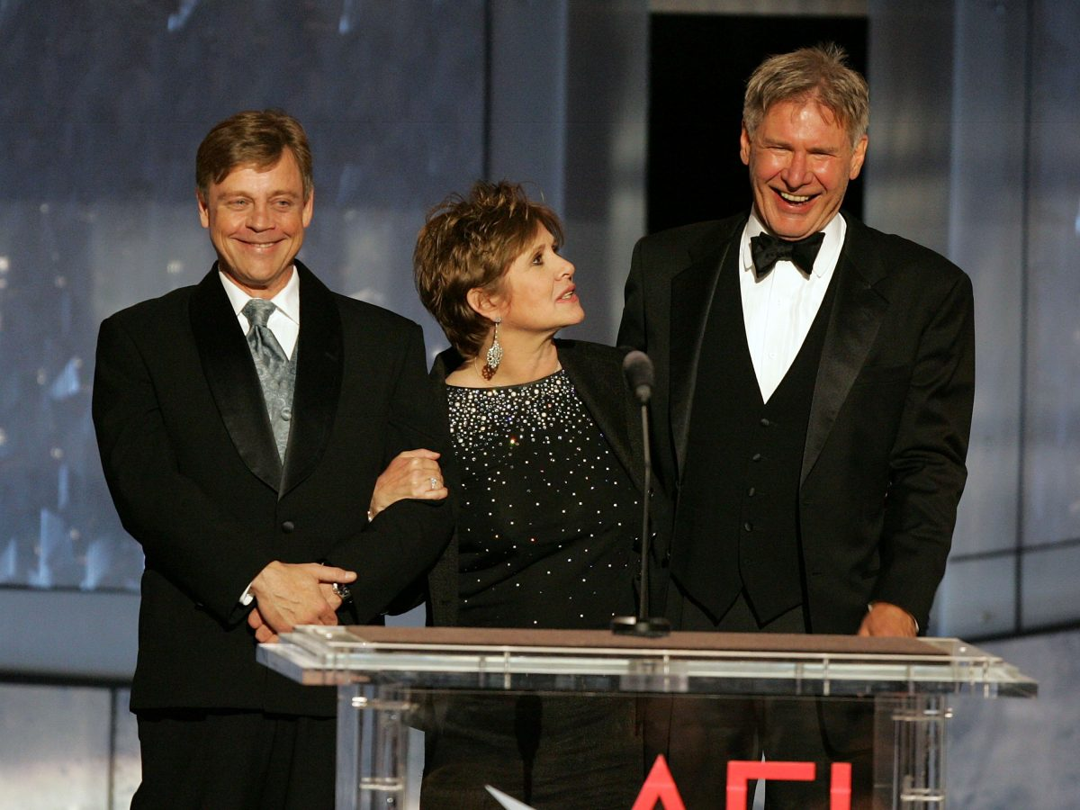 ctors Mark Hamill, Carrie Fisher and Harrison Ford speak onstage during the 33rd AFI Life Achievement Award tribute to George Lucas at the Kodak Theatre on June 9, 2005 in Hollywood, California.