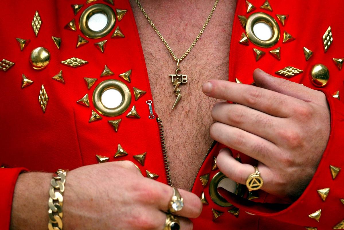 Elvis Presley tribute artist Mark Leen with his 'TCB' pendant in 2002