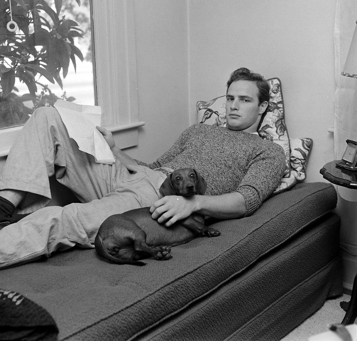 Marlon Brando with his dog in 1949