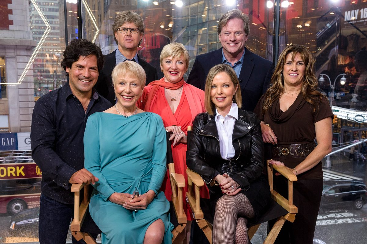 """Matthew Labyorteaux, Michael Landon, Jr., Alison Arngrim, Dean Butler, Lindsay Greenbush, (L-R seated) Karen Grassle, and Melissa Sue Anderson of 'Little House On The Prairie' visit """"Extra"""" at their New York studios at H&M in Times Square on April 30, 2014 in New York City."""