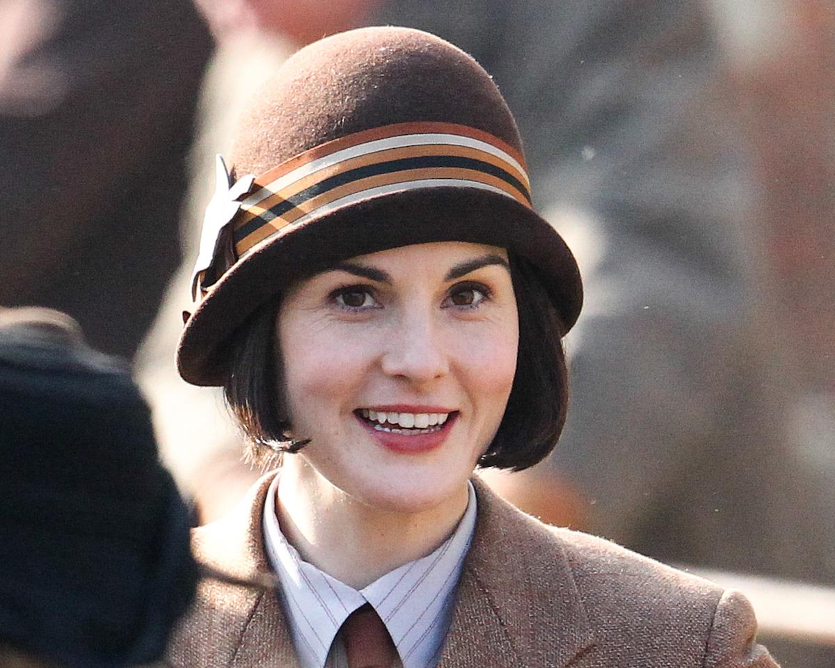 Michelle Dockery wearing a cloche hat on the set of 'Downton Abbey' in 2015