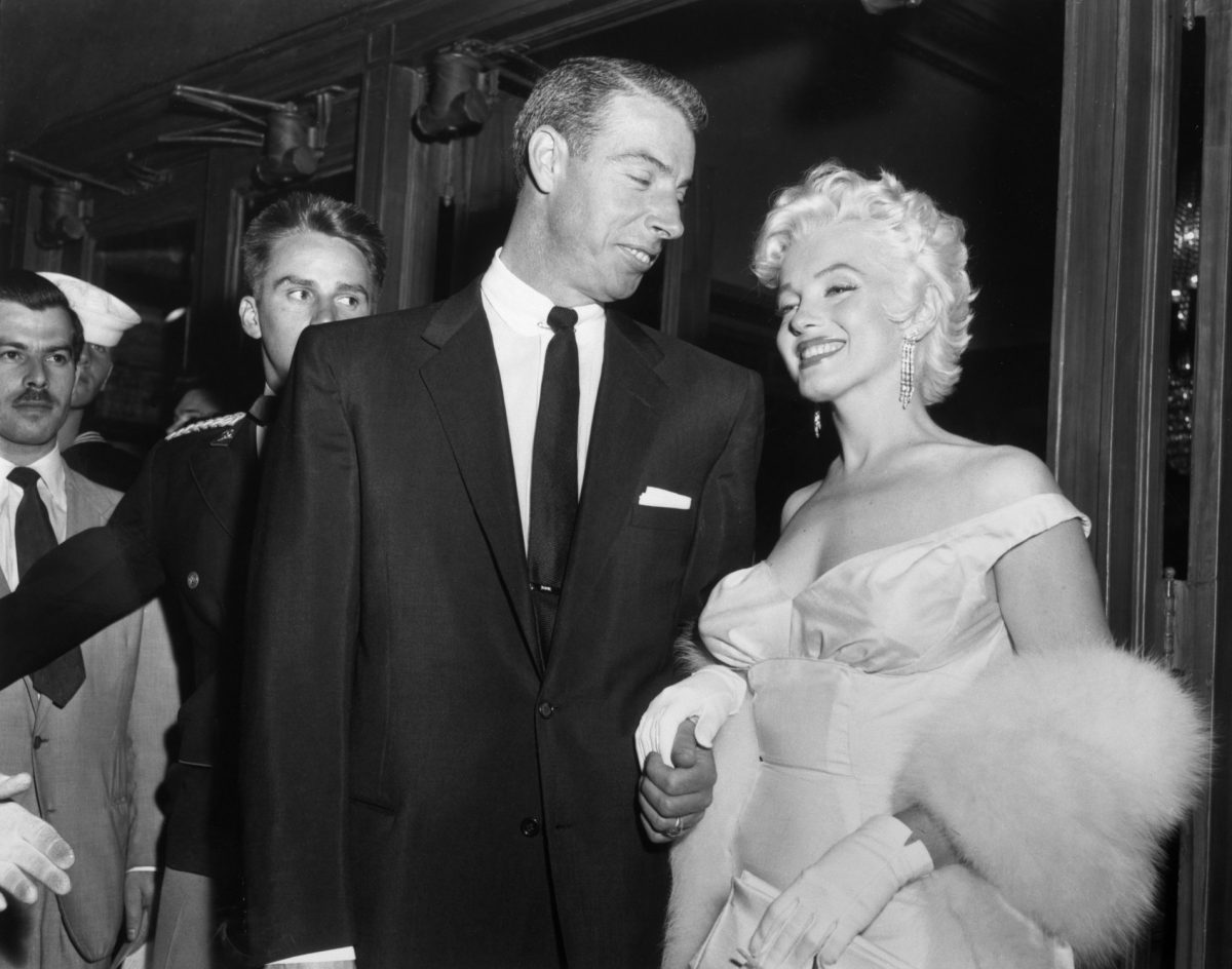 Joe DiMaggio and Marilyn Monroe atttend the premiere of 'The Seven Year Itch'