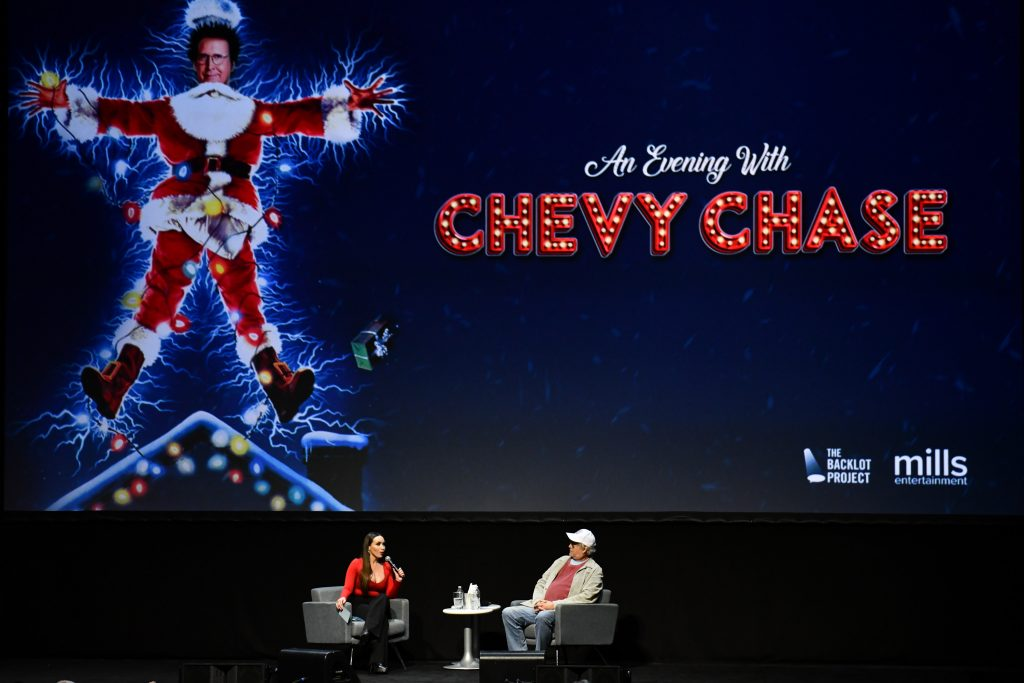 Chevy Chase of 'National Lampoon's Christmas Vacation' speaks with moderator Yenitza Munoz