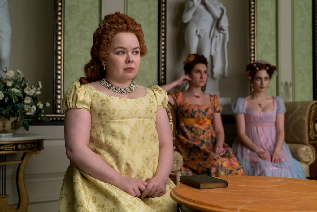 Nicola Coughlan as Penelope Featherington, Bessie Carter as Prudence Featherington and Harriet Cains as Phillipa Featherington in 'Bridgerton'
