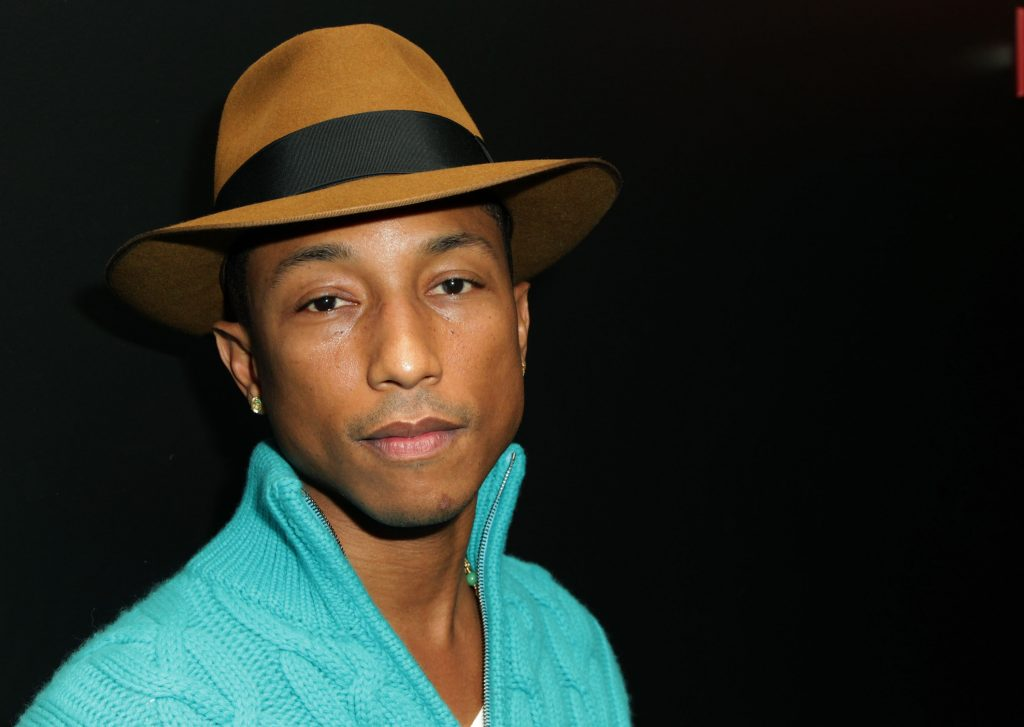 Pharrell Williams poses for a photo at an award show
