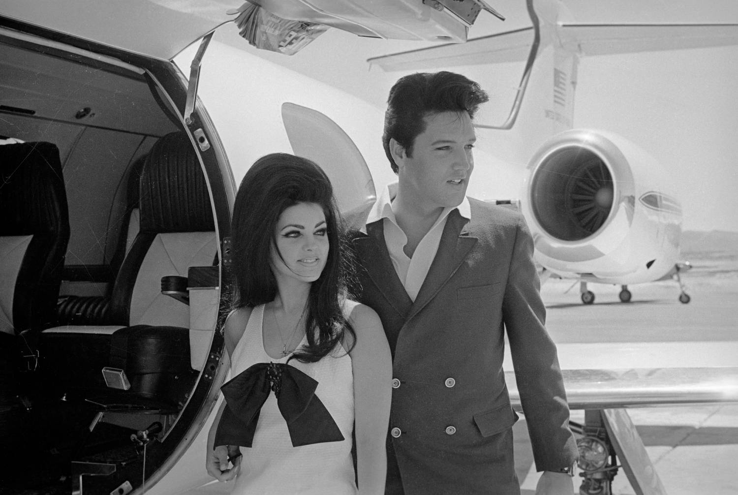 Newlyweds Elvis and Priscilla Presley, who met while Elvis was in the Army, prepare to board their private jet following their wedding at the Aladdin Resort and Casino in Las Vegas.