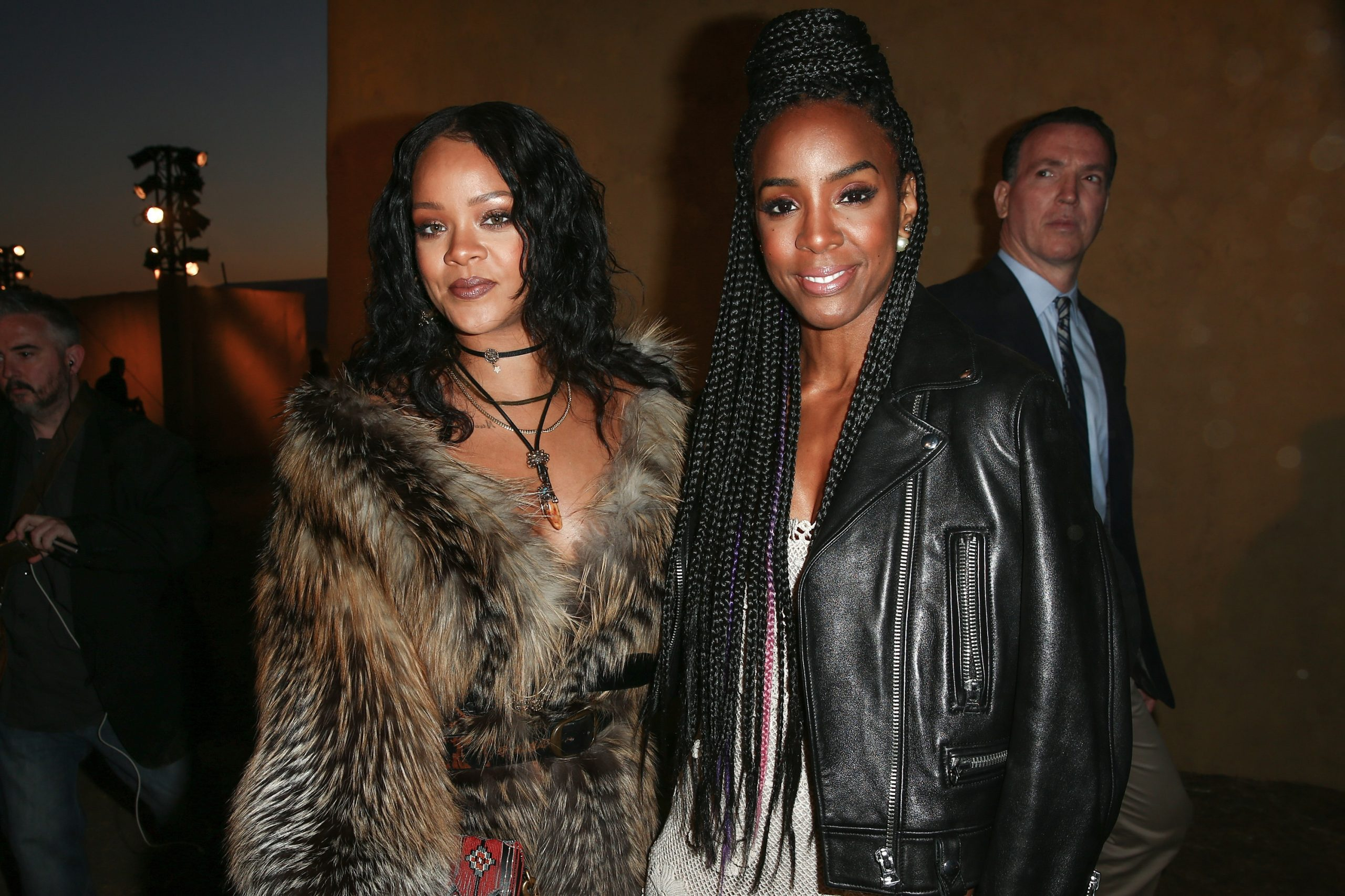 Rihanna and Kelly Rowland pose together for a photo in 2018