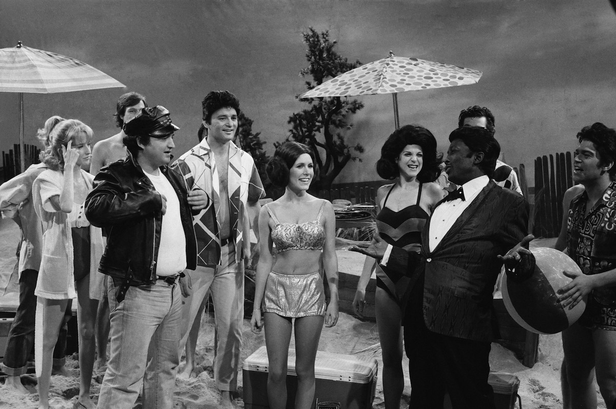 "John Belushi as Eric Von Zipper, Bill Murray as Frankie Avalon, Carrie Fisher as Princess Leia, Gilda Radner as Annette Funicello, Garrett Morris as Chubby Checker during ""Beach Blanket Bimbo from Outer Space"" skit"