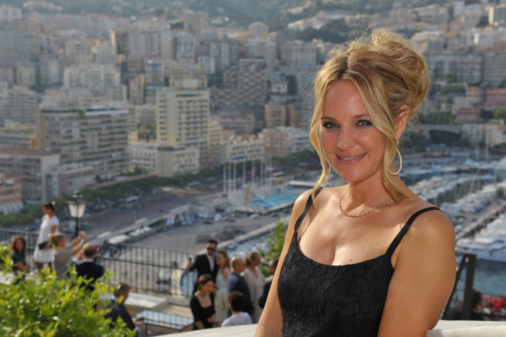 Sharon Case smiling in front of a cityscape