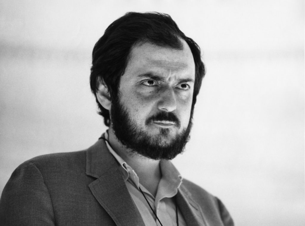 Stanley Kubrick looks on during a shoot