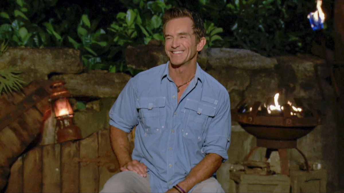 Jeff Probst on 'Survivor: Winners at War,' wearing one of his signature blue button downs and smiling