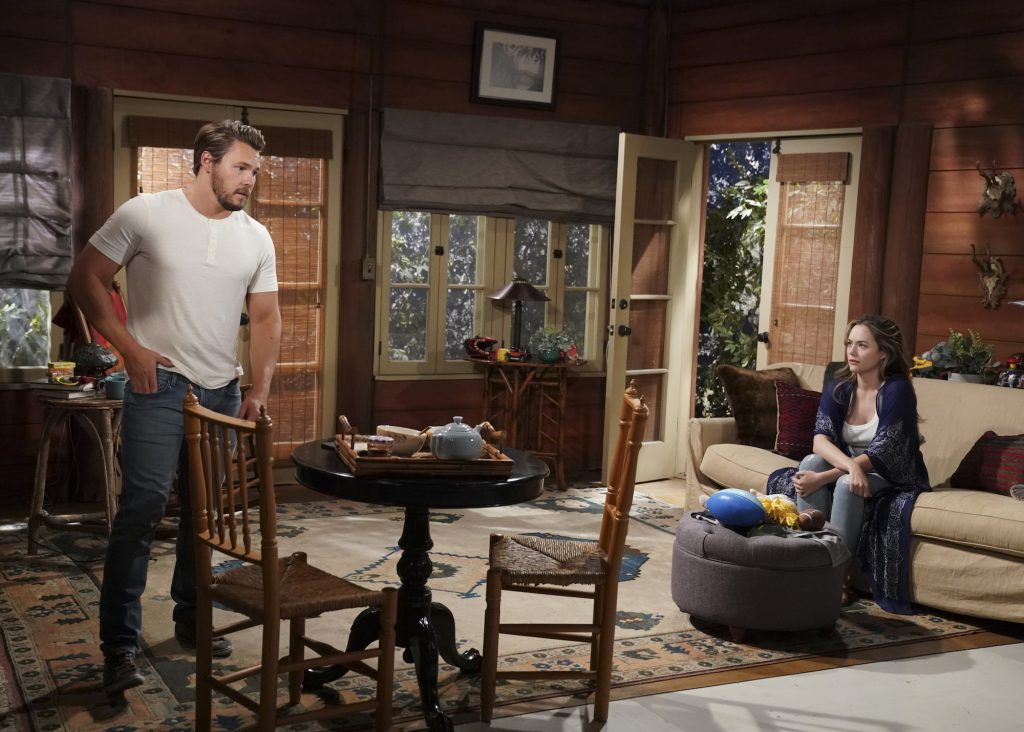 (L-R) Scott Clifton and Annika Noelle sitting across the room from each other on 'The Bold and the Beautiful'