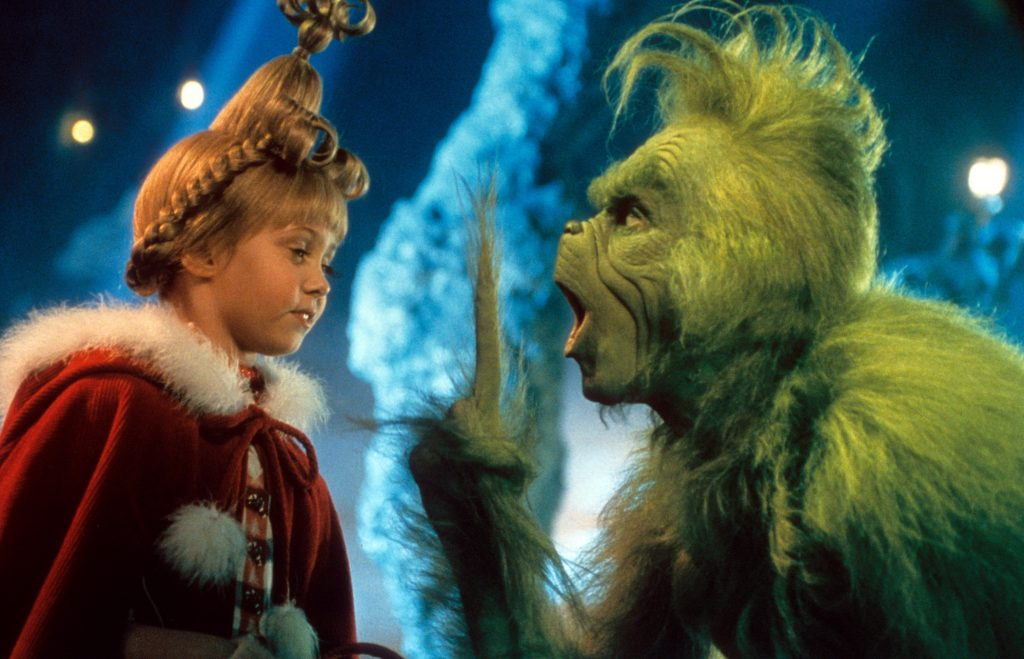 Taylor Momsen listening to Jim Carrey in a scene from the film 'How The Grinch Stole Christmas'