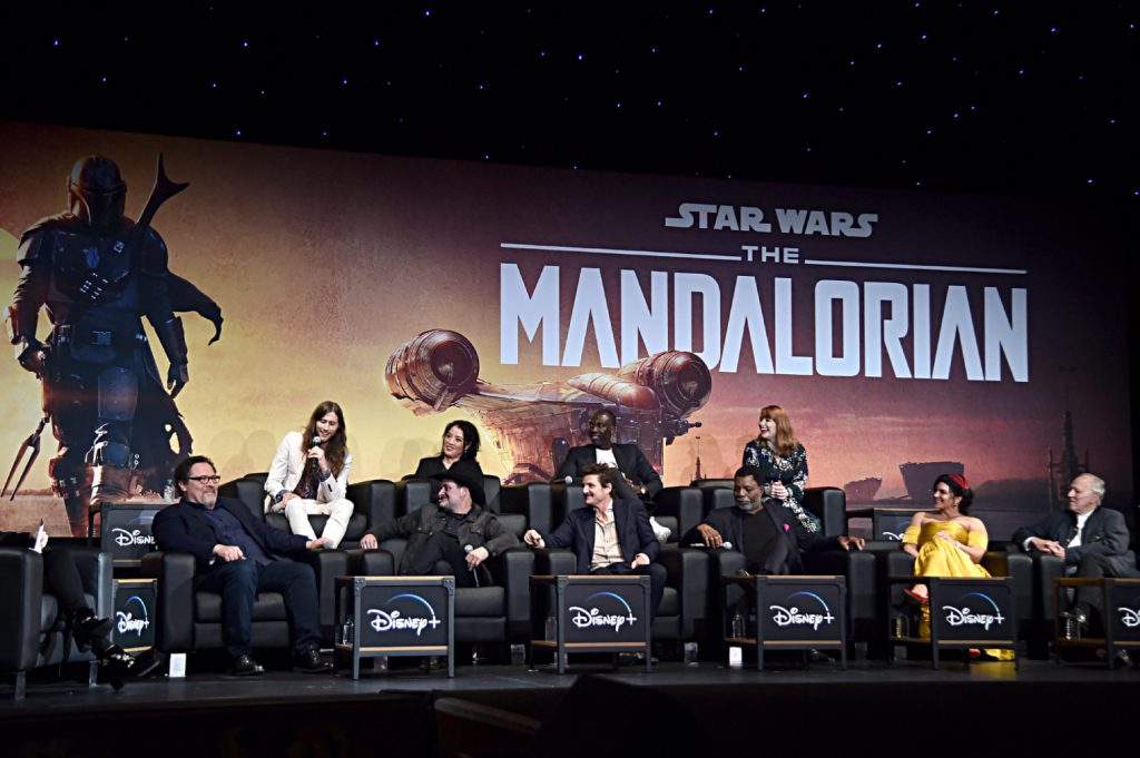 Cast members and crew from 'The Mandalorian' answer questions at an event
