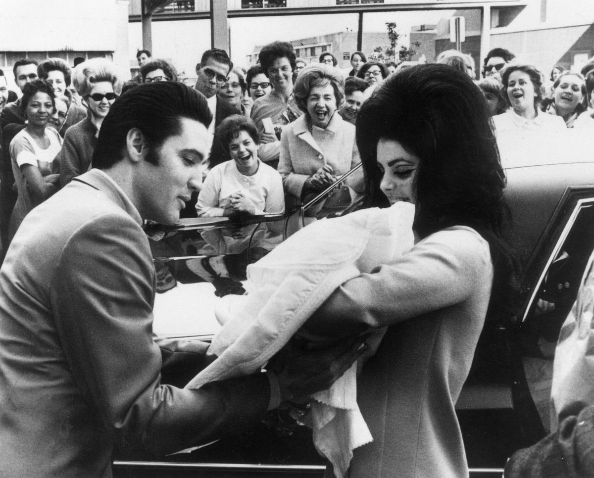 Elvis and Priscilla Presley with baby Lisa Marie Presley