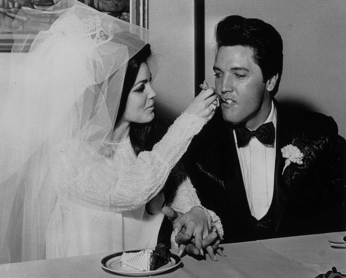 Elvis Presley and Priscilla Presley at their wedding