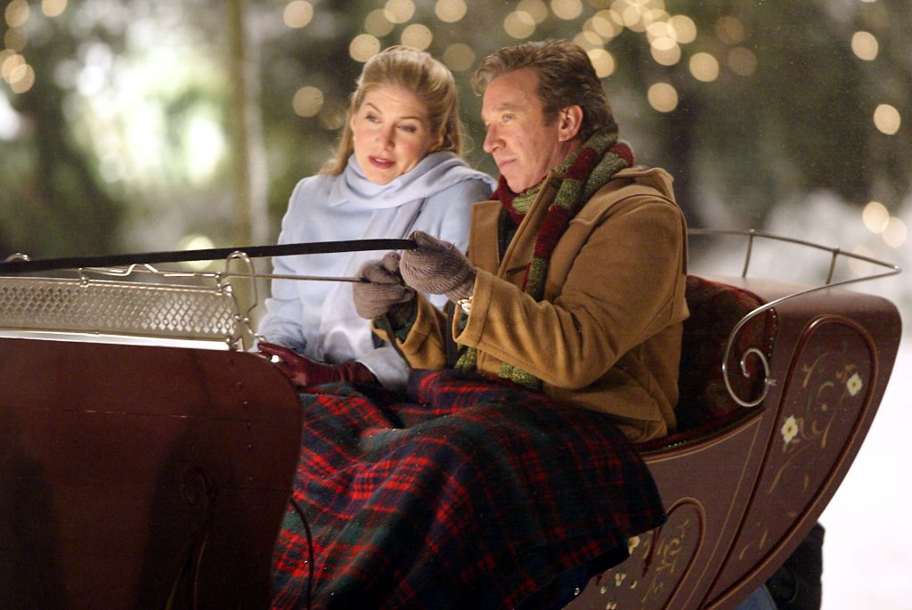 Actors Elizabeth Mitchell and Tim Allen act in a scene on the set of 'The Santa Clause 2'